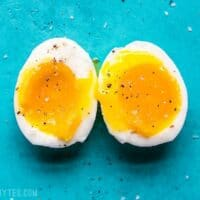 A perfectly cooked soft boiled egg cut open to reveal the silky yolk.