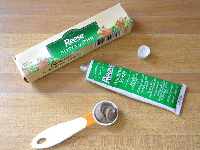 Anchovy Paste tube with measuring spoon next to it