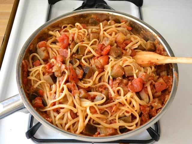 Cooked pasta added to skillet with sauce mixture