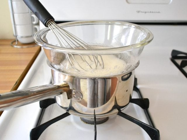 Double boiler created with mixing bowl on top of pan on stove top