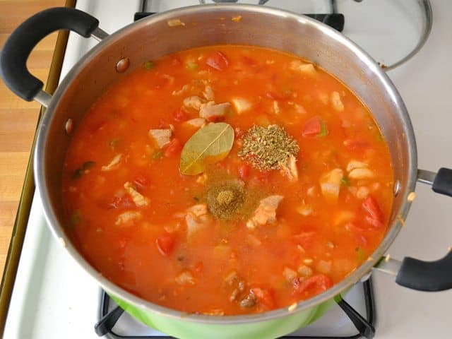 Tomatoes and chicken broth added to pot with other ingredients