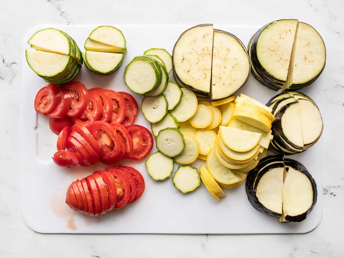 Sliced eggplant, squash, zucchini, and tomatoes