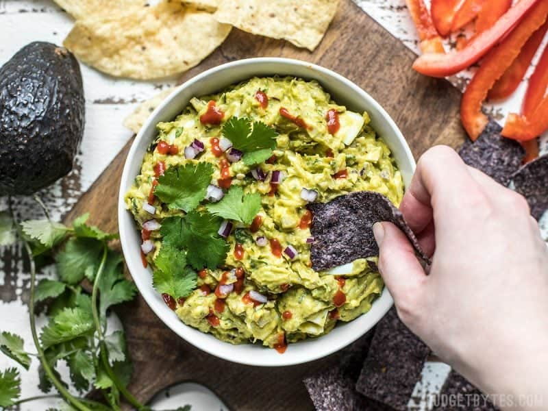 This unique blend of sweet pineapple, spicy sriracha, zesty red onion, creamy avocado, and rich hard boiled eggs makes this the Best Ever Avocado Dip. You'll never eat plain guacamole again. BudgetBytes.com