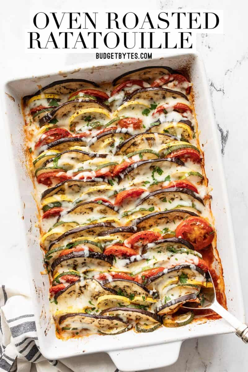 oven roasted ratatouille in a rectangular casserole dish, title text at the top