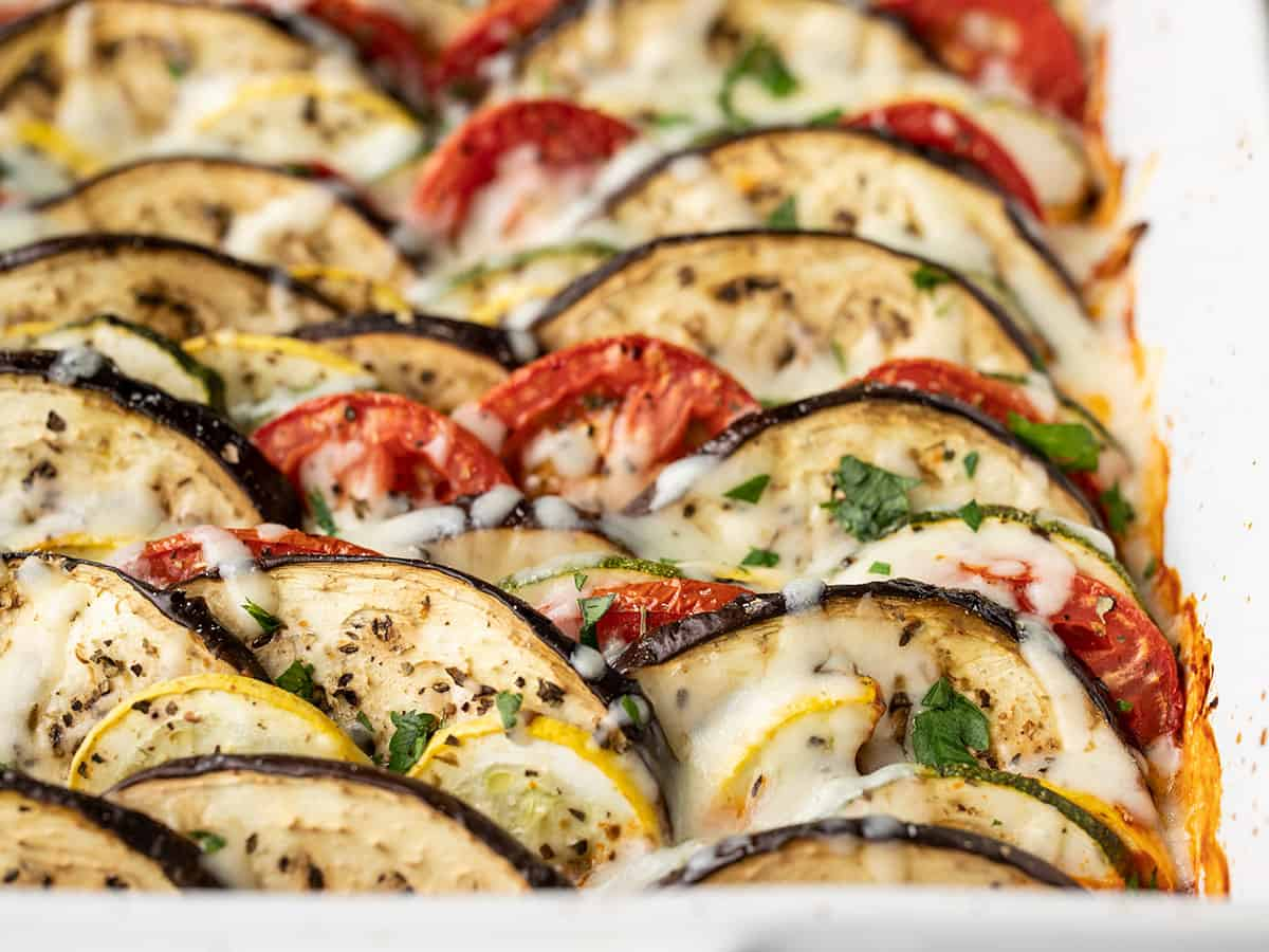 Close up side view of ratatouille in the casserole dish