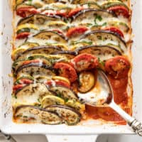 oven roasted ratatouille with a portion scooped out of the corner