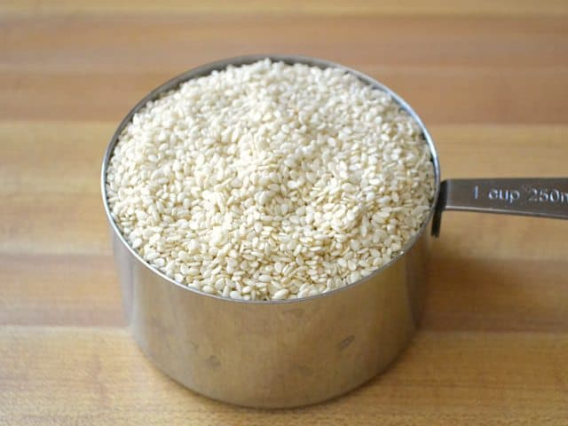 Sesame Seeds in measuring cup