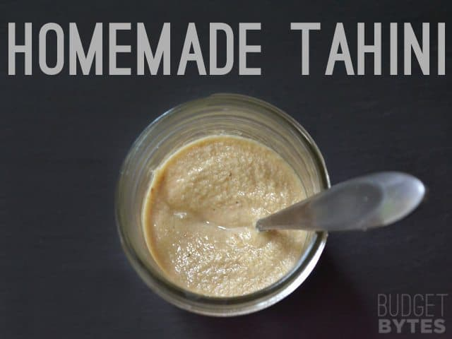 Homemade Tahini in jar with spoon