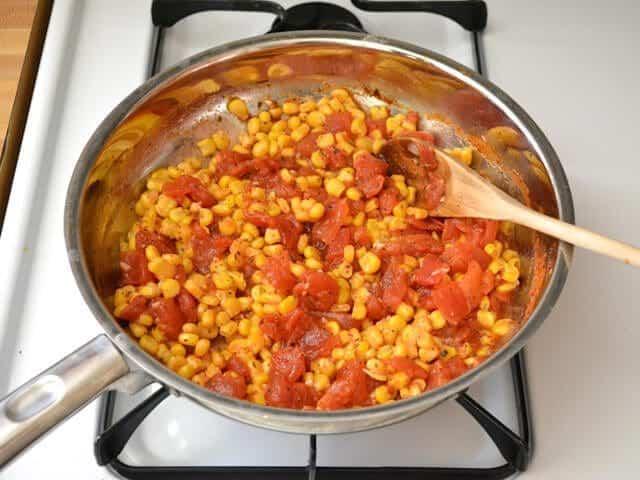 Frozen corn added to skillet