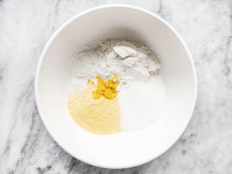 Dry ingredients for lemon blueberry cornbread in a bowl.