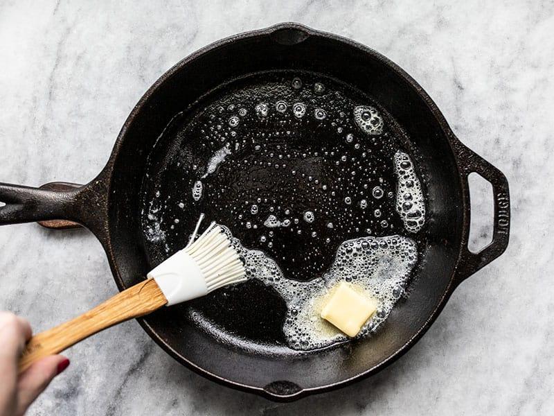 Melt Butter in Hot Skillet brush up the sides