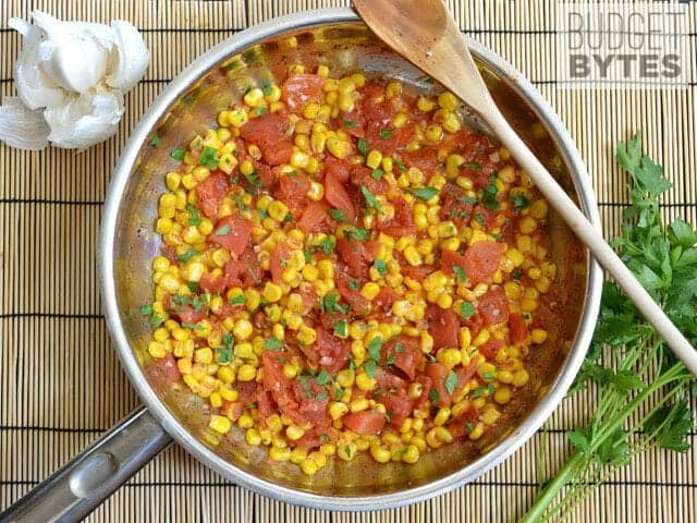 Sautéed Corn and Tomatoes with parsley sprinkled on top