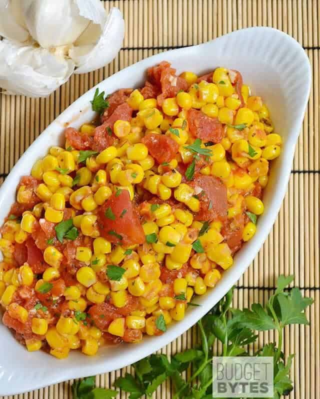 Top view of Sautéed Corn and Tomatoes in white dish