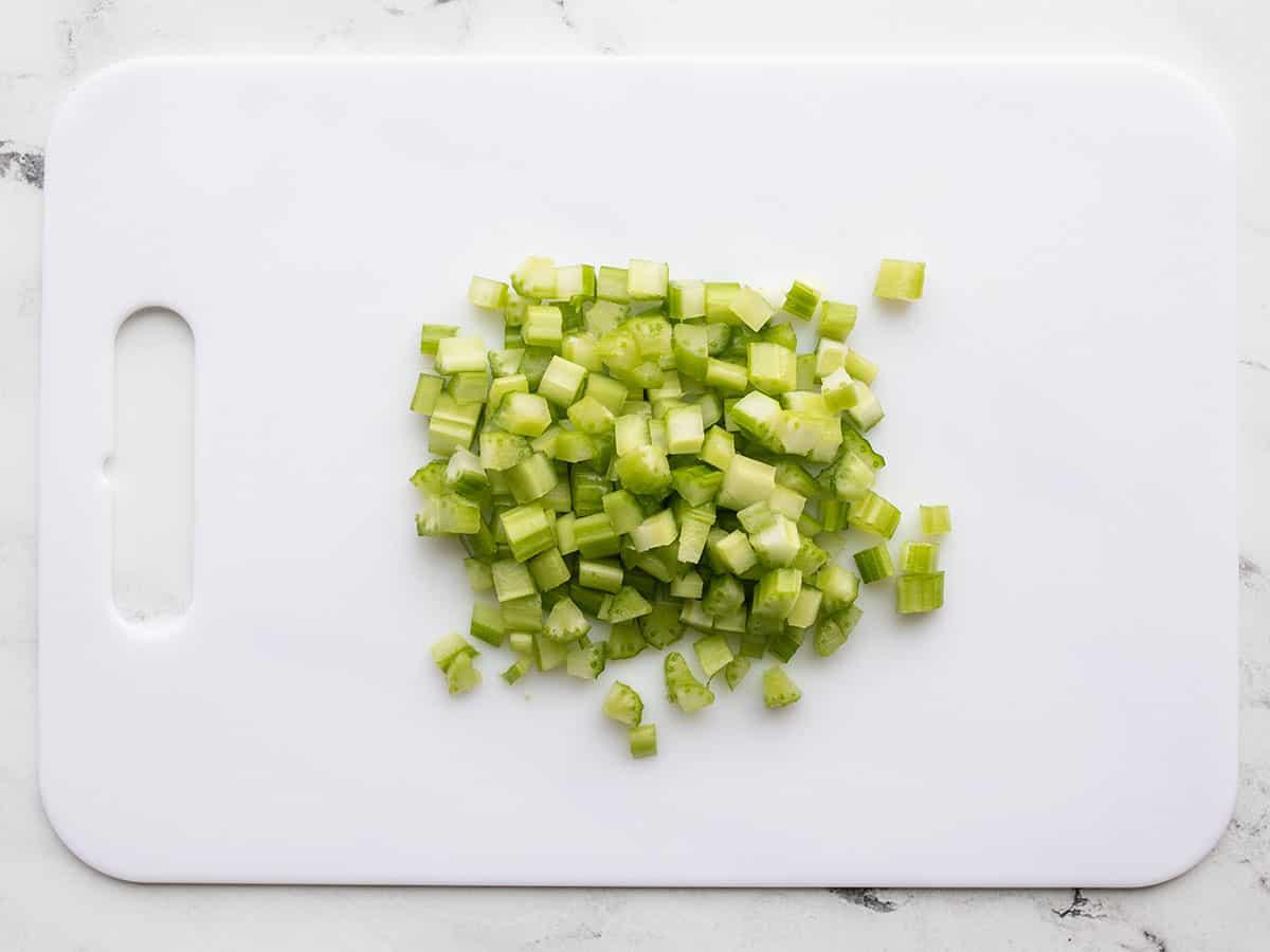 Chopped celery on a cutting board