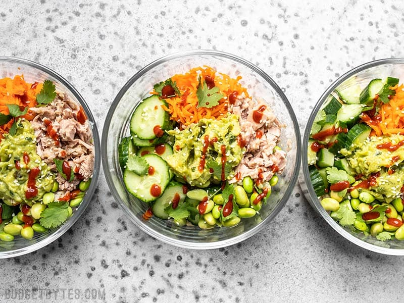 Meal prepped Spicy Tuna Guacamole Bowls in round glass containers