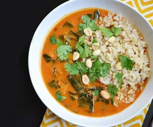 A bowl of West African Peanut Stew with Brown Rice and Cilantro
