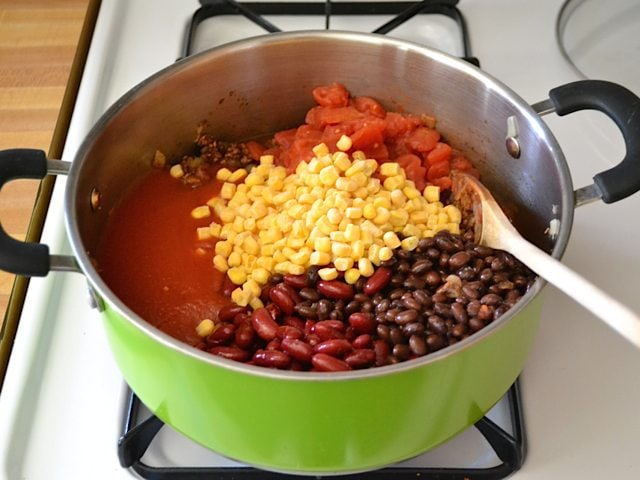 Add beans, tomatoes, corn to pot
