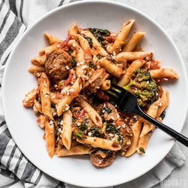 "This super easy and satisfying, ""sweep the kitchen"" Penne Pasta with Sausage and Greens is an entire meal in one pot. Cook once, eat all week."
