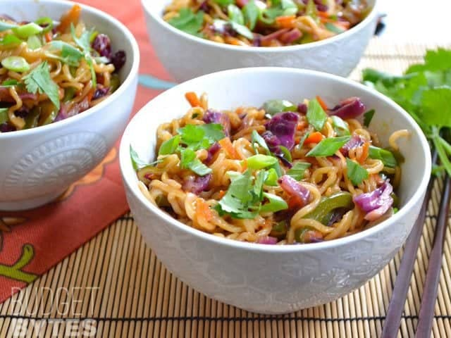 Close up of a bowl of vegetable stir fry with noodles