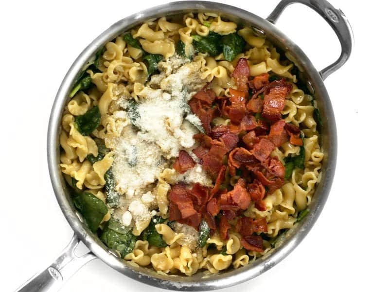 Bacon and parmesan cheese added to skillet with the rest of the ingredients