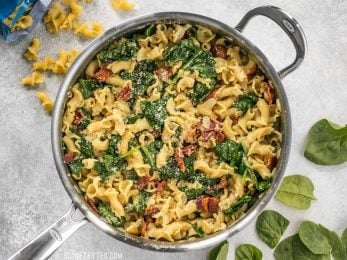 Bacon and Spinach Pasta with Parmesan is a quick and flavorful weeknight dinner that only requires a few ingredients. BudgetBytes.com