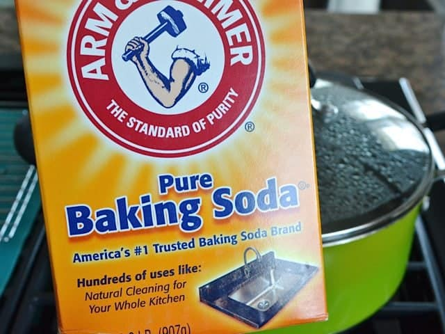 Baking soda ready to be poured into pot of boiling water