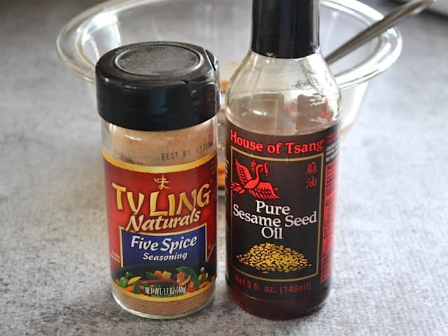Five Spice and Sesame Oil bottles with bowl in background