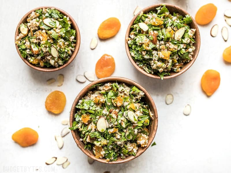 This Parsley Salad with Almonds and Apricots is savory, sweet, crunchy, and drenched in a tangy homemade vinaigrette! Holds up well to refrigeration and perfect for meal prep! Budgetbytes.com