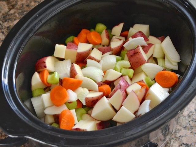 Chopped Vegetables in Slow Cooker for Rosemary Garlic Beef Stew