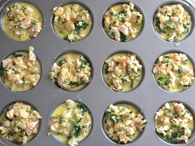Egg mixture poured over solid mixture in muffin tin
