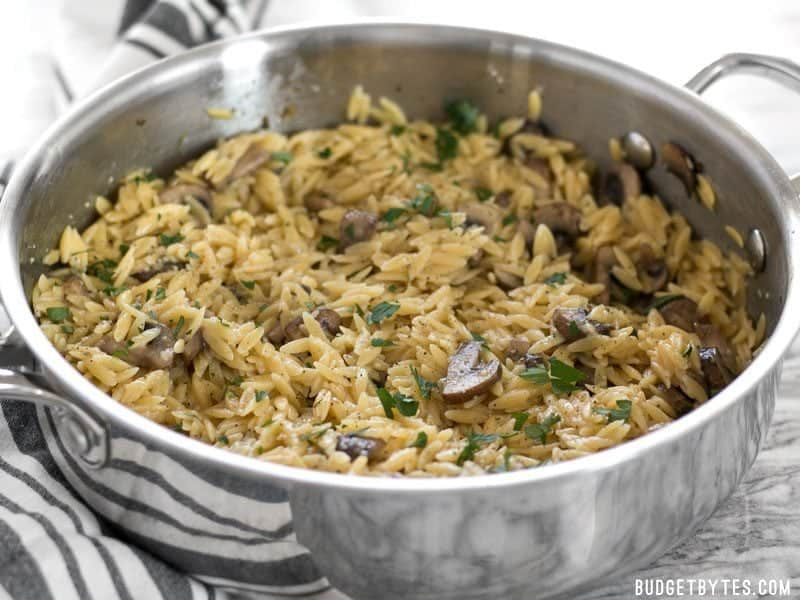 Front view of the skillet full of Parmesan Portobello Orzo