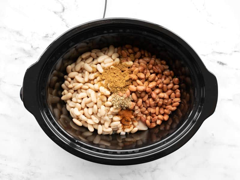 Beans and spices added to slow cooker