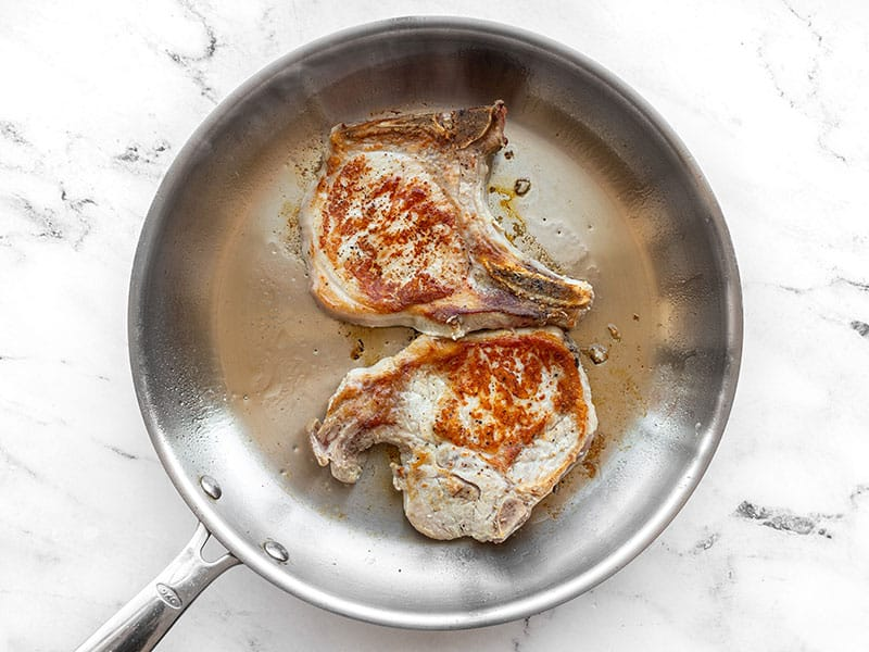 Seared pork chops in a skillet