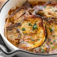 baked honey mustard pork chops in a casserole dish from the side