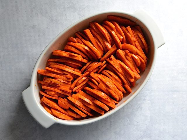 Sweet Potatoes arranged standing upright in stacks in casserole dish, Ready to Bake