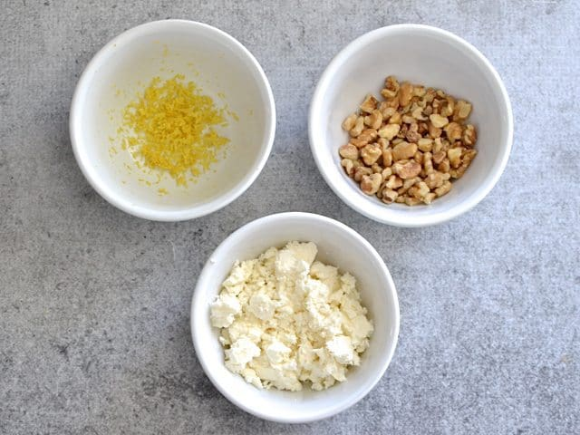 Toppings (three small bowls, one with lemon zest, one with feta cheese and one with walnuts)