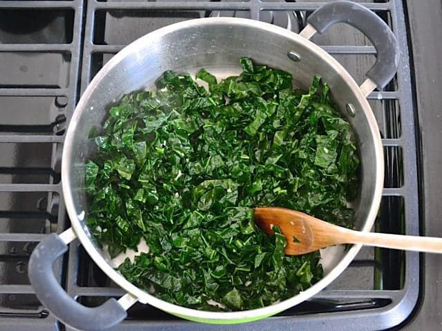 Kale added to pot to cook