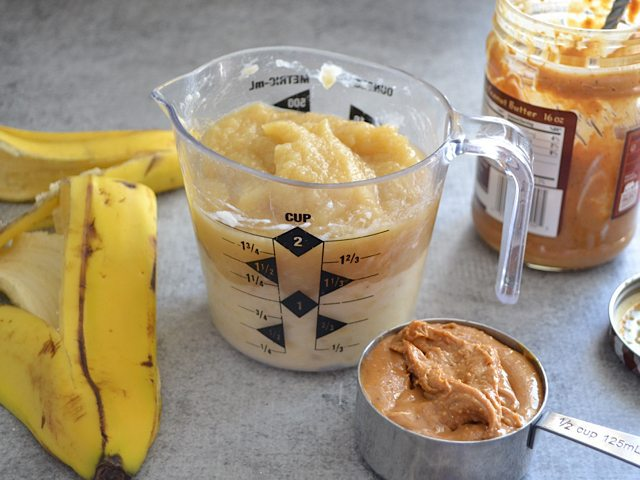 Mashed Bananas, Apple Sauce and peanut butter in measuring cup