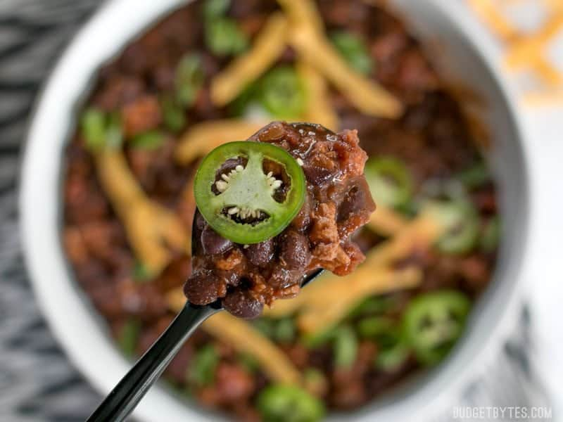 This warm and comforting black bean chili is fast enough to pull together on a busy weeknight and soothing enough to make the stress of the day melt away. BudgetBytes.com