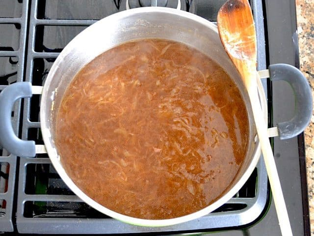 vegetable broth added to pot with seasoned onions