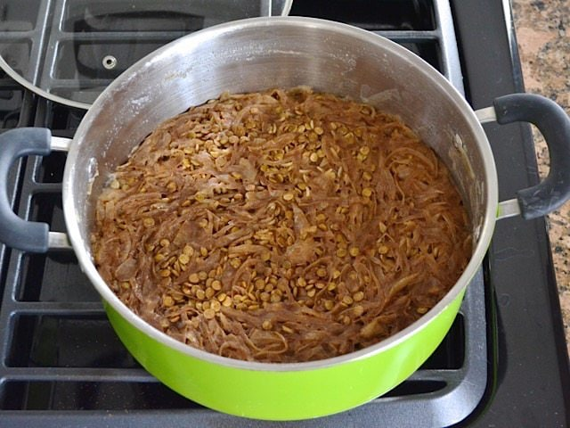 Cooked Mujaddara in pot on stove top