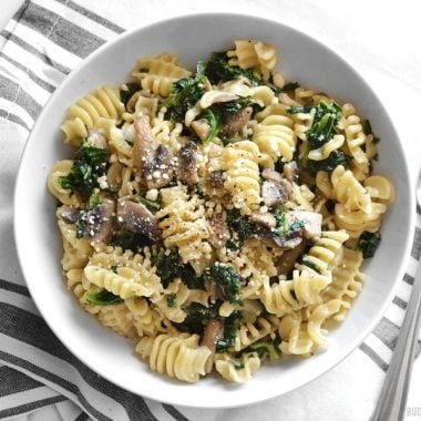 Parmesan & Pepper Kale Pasta is a quick and easy weeknight meal. Just a few ingredients transform boring pasta into a fancy meal. BudgetBytes.com