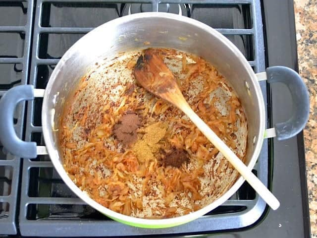 Spices added tot pot with onions