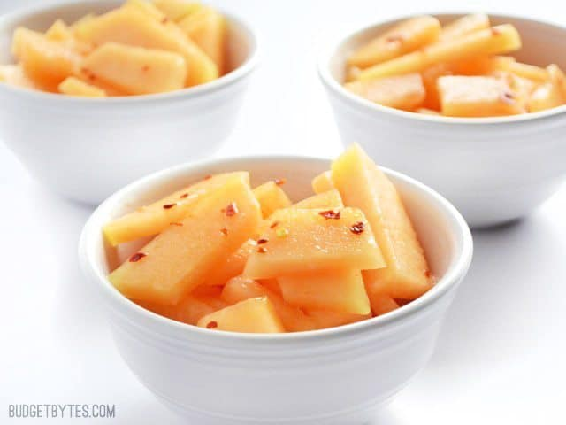 Three small white bowls of Chili Lime Cantaloupe