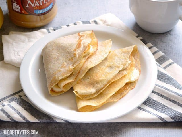 Three filled Homemade Crepes  folded and placed on plate
