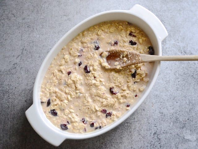 Mixture poured into casserole dish and spread out with wooden spoon
