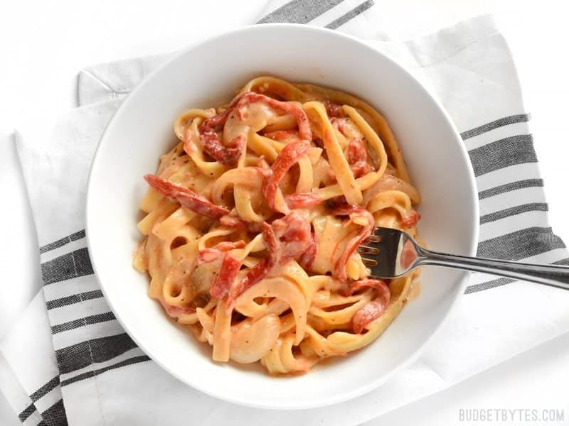 A bowl of One Pot Roasted Red Pepper Pasta with some wound around a fork