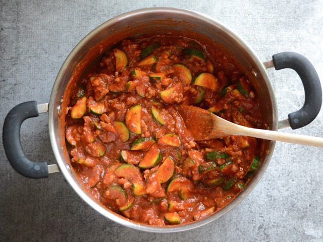 Pasta sauce added to the pot