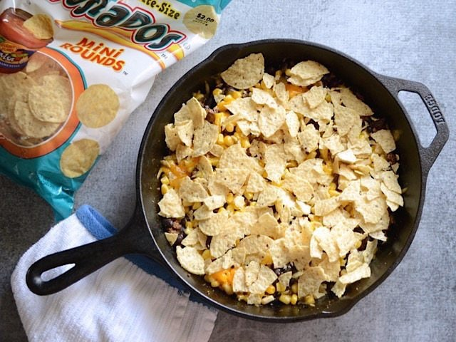 Crushed Tortilla Chips added to the skillet