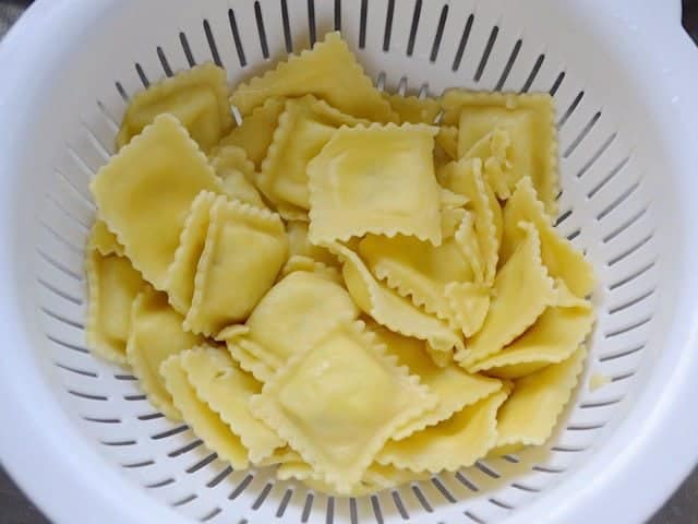 Cooked and drained Ravioli in a colander